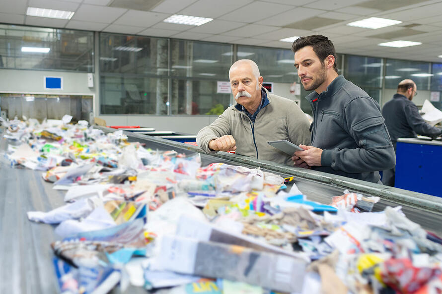 Men looking at waste
